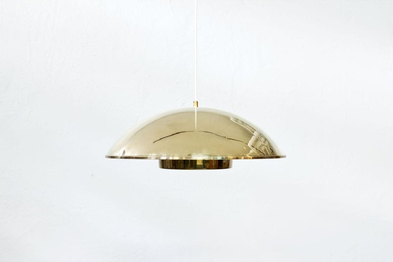 Rare pendant lamp manufactured by Bergboms in Sweden during the 1960s. Made from brass with acrylic and brass diffuser.
