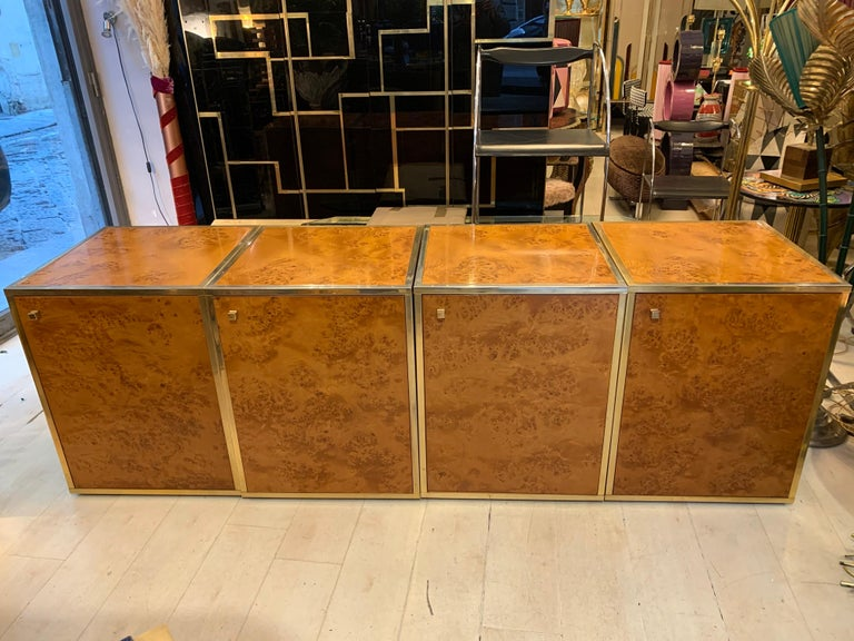 Brass and burl wood sectional credenza compose of four separate pieces, it is basically the result of four pieces put together with a variety of possible options, broken into different pieces it can be divided into two pieces of furniture (each made