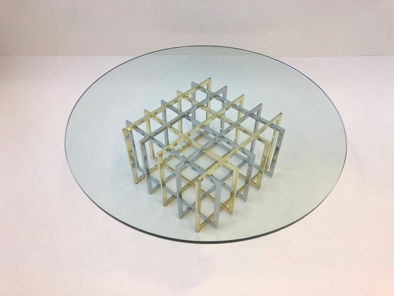 """A glamorous geometric grid table design by Pierre Cardin in the 1970s. The table is constructed of polished brass and polished chrome with a 3/4"""" thick glass top. The table is in original condition, so it shows minor wear. The base is available"""