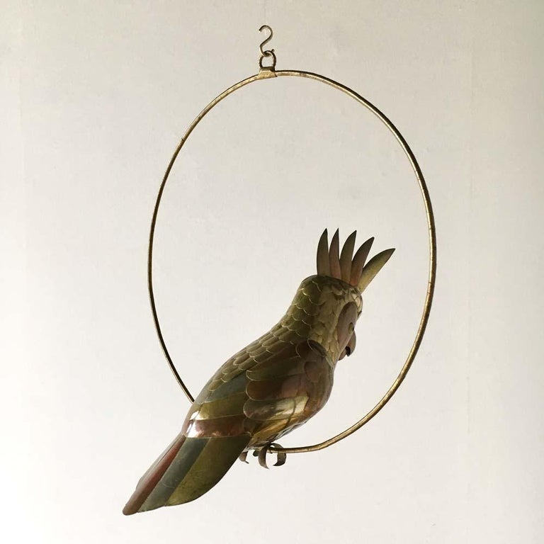 Copper and brass and aluminium cockatoo on a hoop hanging stand by Sergio Bustamante 1960s. 