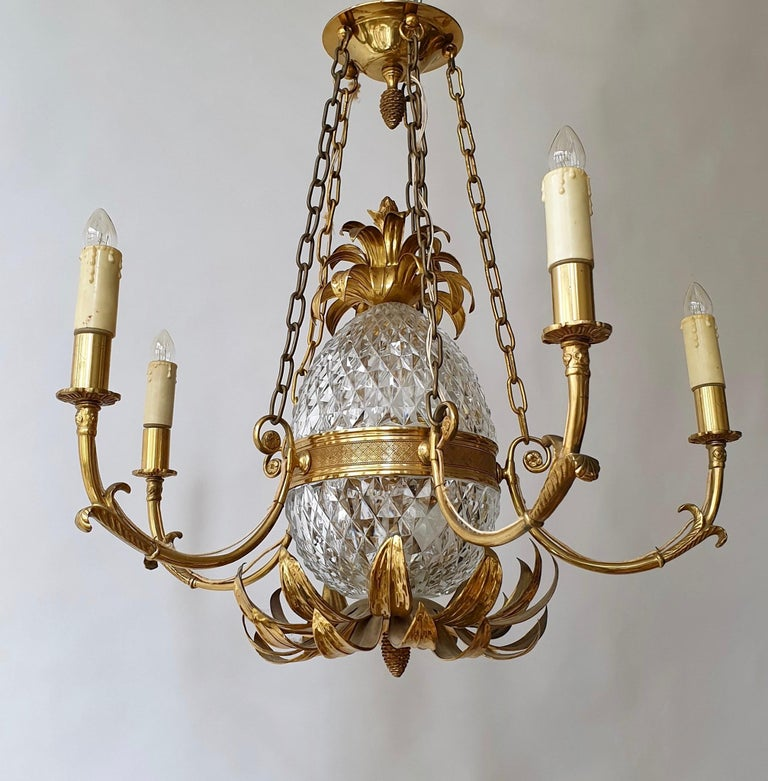Gilt brass and cut crystal pineapple chandelier made in France, circa 1960-1970. It needs 7 x E14 standard screw bulbs to illuminate. After years this gorgeous chandelier stays in a very good to excellent original vintage condition with minor wear