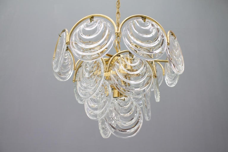 Beautiful chandelier with large glass plates and solid brass. This chandelier comes from the 1960s and is in an very good condition.