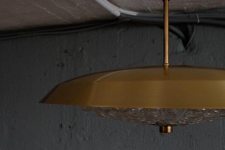 Swedish glass and brass pendant designed by Carl Fagerlund for Orrefors, 1950s. Diameter: 50 cm  Height is adjustable.