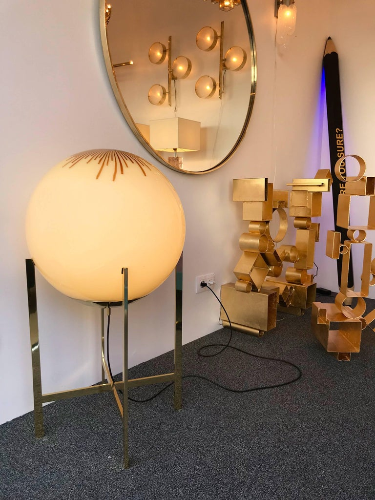 Floor lamps or huge table lamps in blown Murano glass ball and brass feet by the Italian editor La Murrina. The glass is attributed to Ludovico Diaz de Santillana with the anemone glass. Famous manufacture like Mazzega, Venini, Vistosi, Carlo Aldo