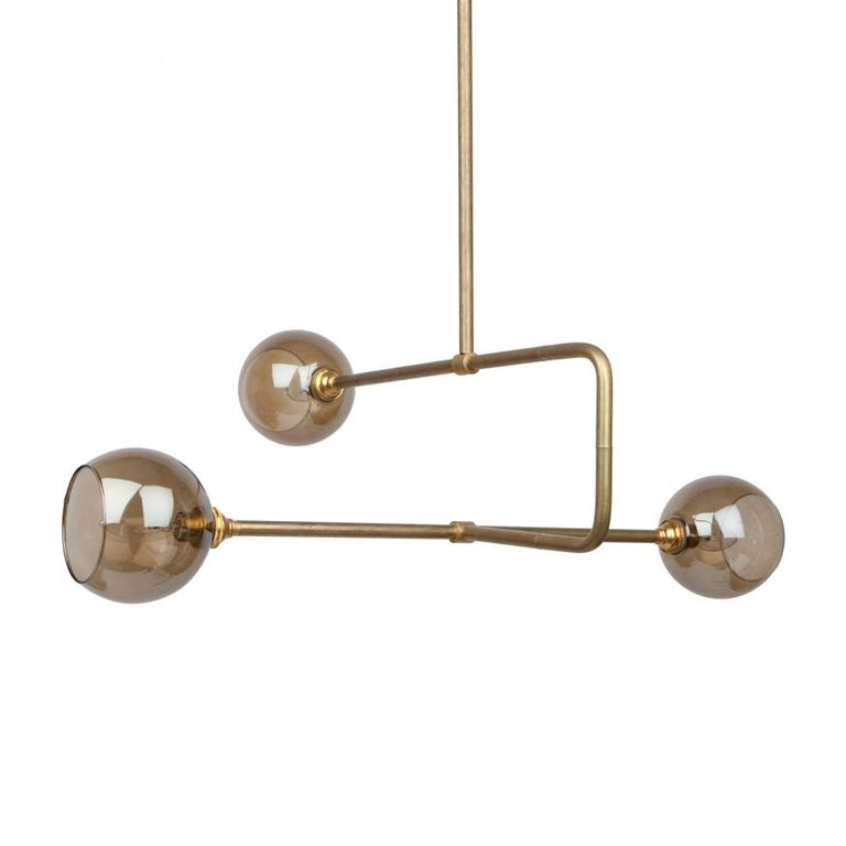 A modern asymmetrical chandelier to illuminate your dining room, living room, kitchen. This contemporary lighting pendant also works well in a commercial setting restaurant, retail, or office space. The circuit lighting collection was named because