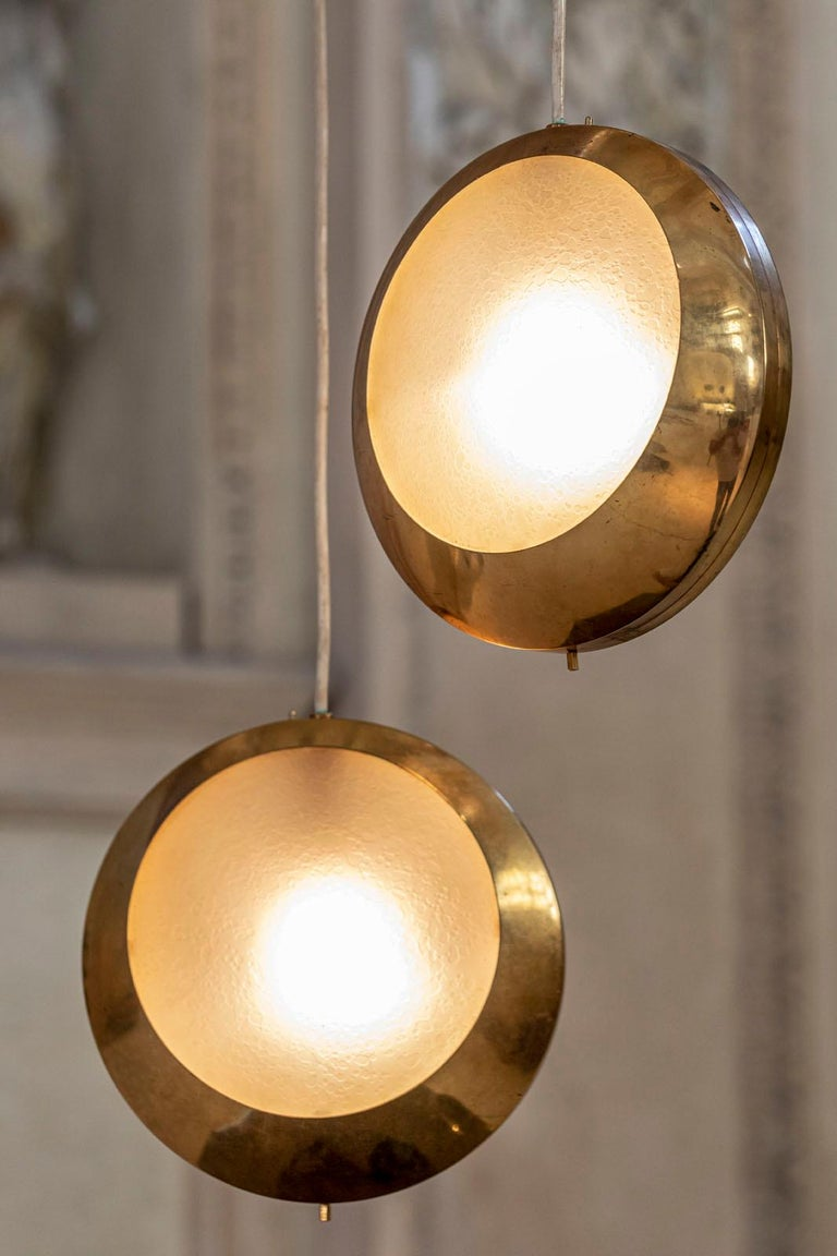 Rare brass and etched glass pendant manufactured by Stilnovo. Black lacquered structure with 2 pendant, original label.