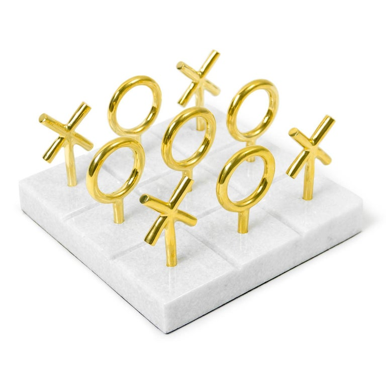 Raise your game. Play to win with our posh brass and marble Tic-Tac-Toe set. The grooved marble base is the perfect board for our sculptural brass playing pieces. Each piece in our collection of brass bibelots is designed and sculpted by Jonathan