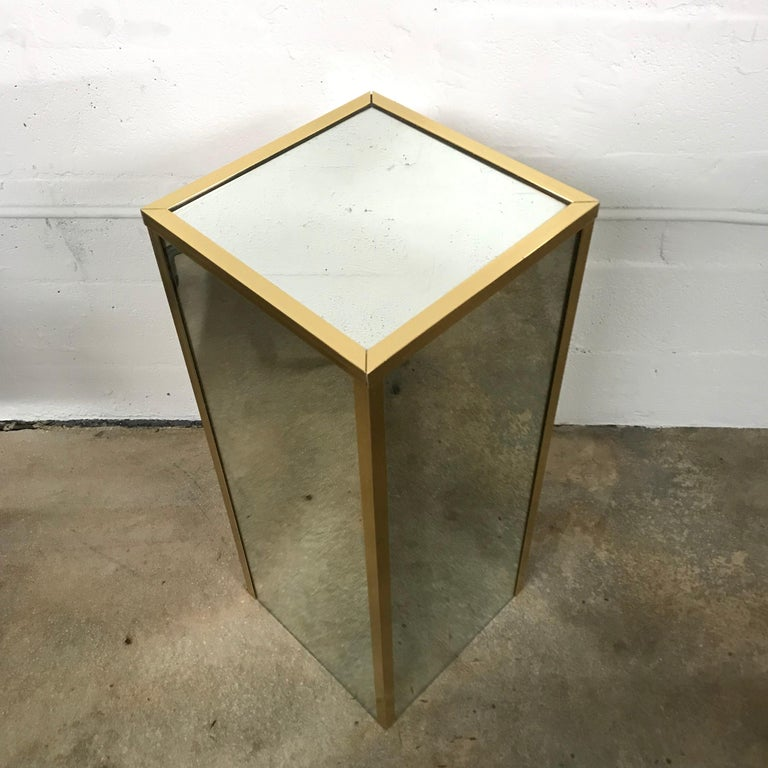 Brass banded pedestal with mirror insets, 1970s.