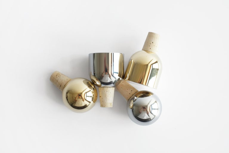These new sphere and dome shaped wine stoppers appear to float as they sit on top of a favorite bottle of open wine. They will make you want to save some of the bottle for the next day (well, almost).   The mirror polished finish illuminates the
