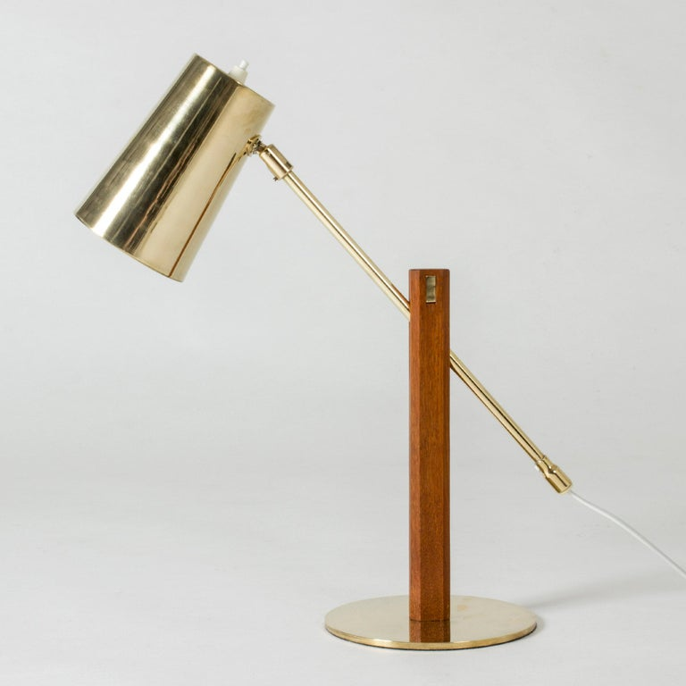 Brass table lamp with a teak handle by Hans Bergström. Adjustable angle of the lamp shade, amazing details.