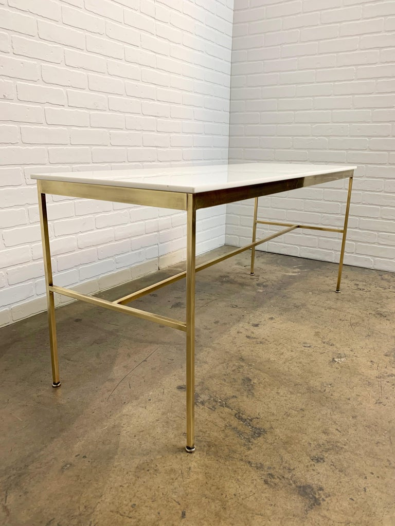 Brass and Vitrolite / milk glass console table by Paul McCobb.