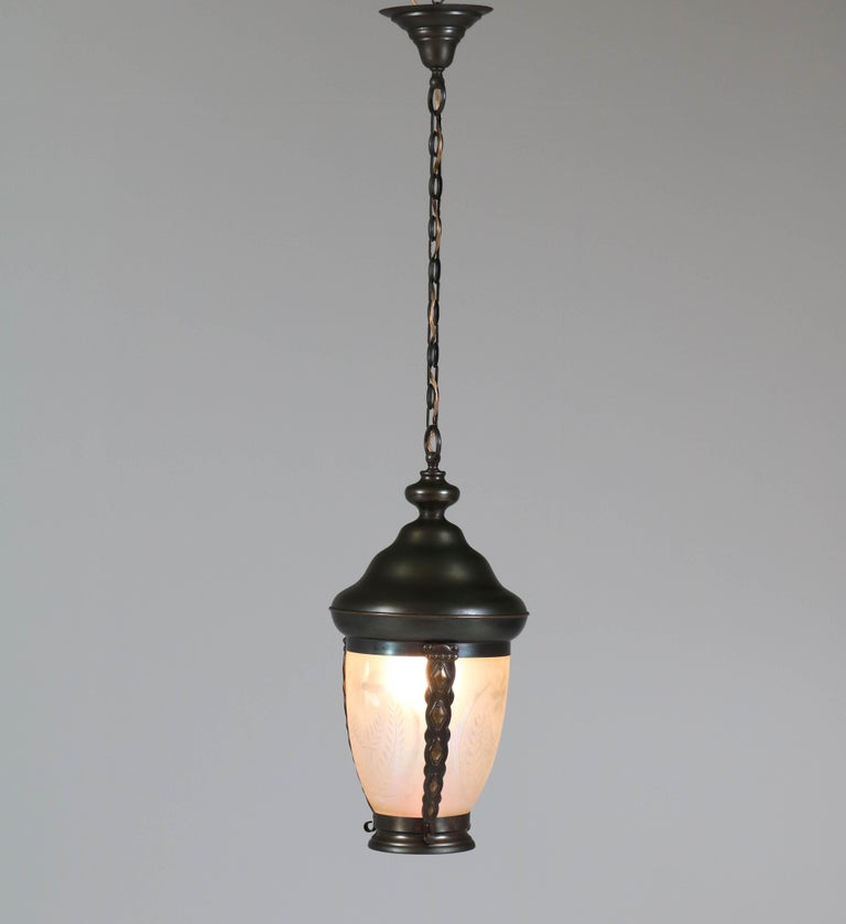 Wonderful Art Nouveau large pendant lamp or lantern. Patinated brass frame with original beveled petrol glass shade. Striking Dutch design from the 1900s. In good original condition with minor wear consistent with age and use, preserving a