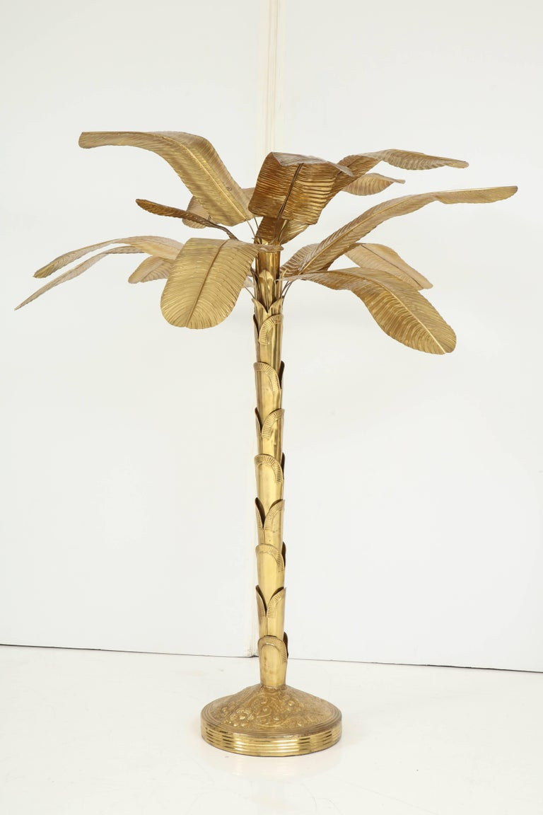 This wonderful brass banana tree adds a whimsical and bright touch to any room. A true work of art crafted to truly resemble the real thing -- minus the fruit, of course! The sculptural trunk in a round, decorated base, supports leaves with
