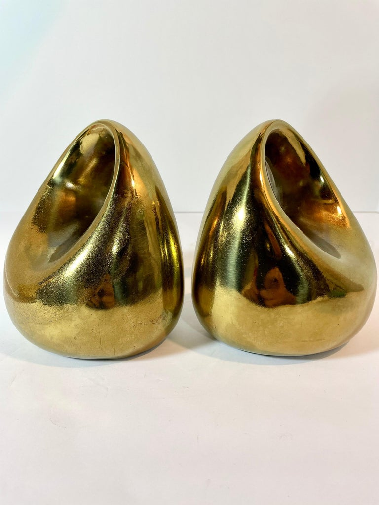 Modernist set of brass-plated bookends by Ben Seibel for Jenfred-Ware and sold by Raymor. some areas of wear or use, minor marks or nicks, please see pictures. These present nicely. Measures: 5.75