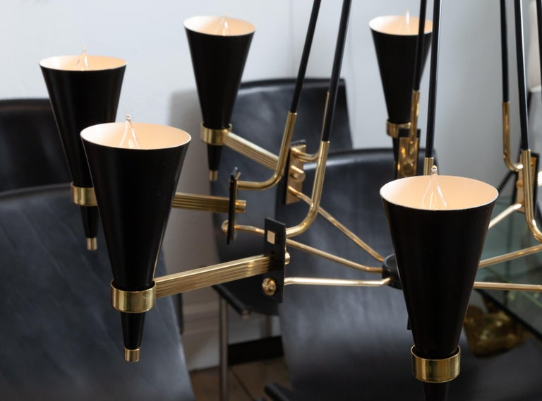 Italian Brass and Black Enameled Metal Chandelier Featuring Conical Shades, by Stilnovo For Sale