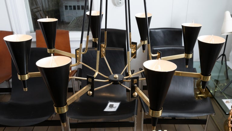 Brass and Black Enameled Metal Chandelier Featuring Conical Shades, by Stilnovo In Excellent Condition For Sale In Bridgehampton, NY