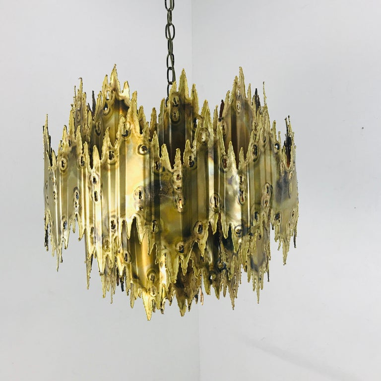 Torch cut and patinated brass chandelier by Tom Greene for Feldman.