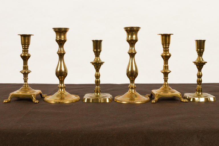 Brass candleholders from late 19th century, set of 6. Three pairs of antique candlesticks in solid brass. Good condition.