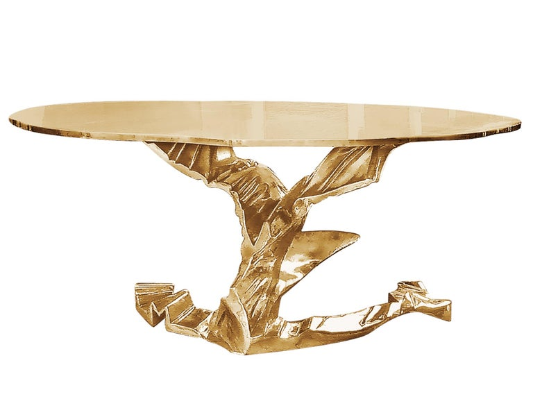 Hand sculpted in a Brutalist style, this organic table holds a 60