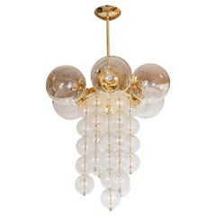Brass Chandelier Composed of Multiple Clear and Textured Glass Ball Elements