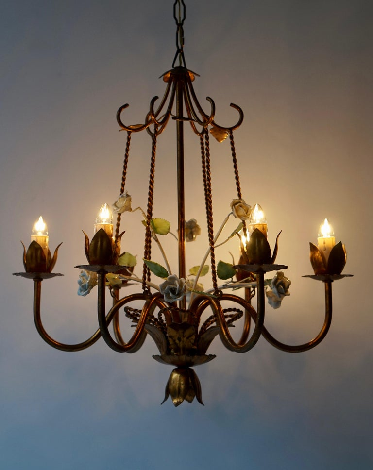 Brass white flower chandelier with six arms.  Diameter 50 cm. Height fixture 52 cm. Total height with the chain is 100 cm.