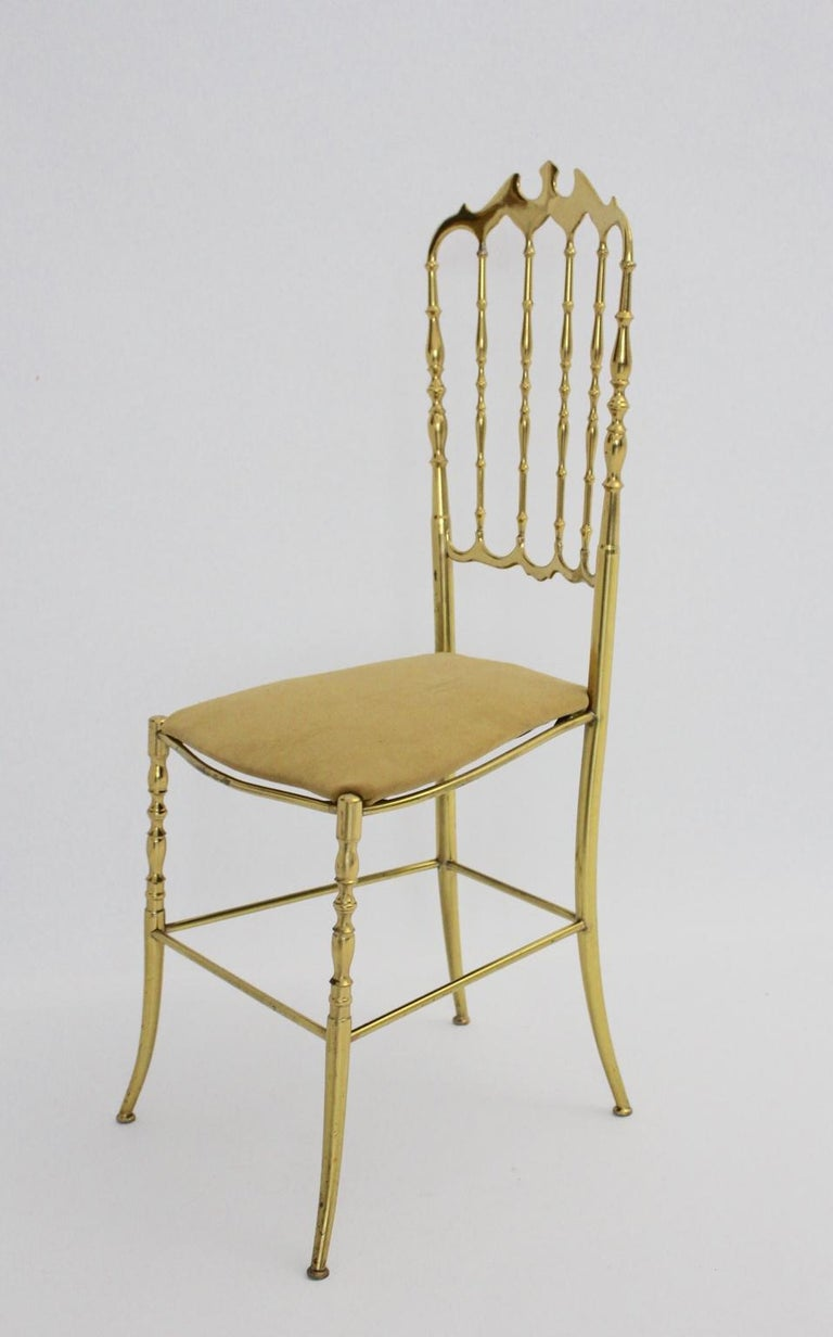 Beautiful Chiavari brass chair The seat is newly covered with light-brown velvet fabric.  The condition is very good with minor signs of age and use and shows a great brass patina. all measures are approximate
