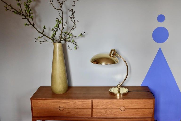 Original brass Christian dell desk lamp model 6631 Luxus / president for Kaiser Idell, Germany. Solid brass shade, arm and rim. Arm and shade adjustable. With E26/27 Edison screw socket. Very nice condition and ready to use with 110 and 250V.