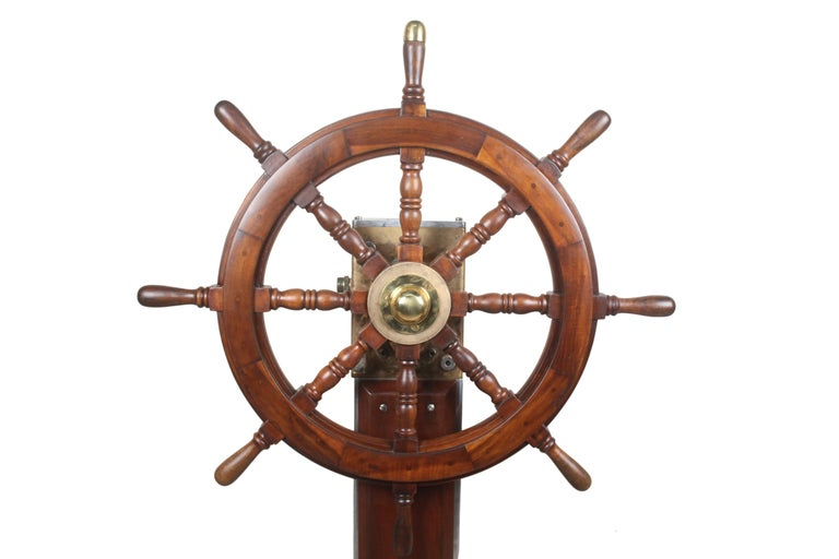 A rare find, this Norwegian teak, brass and chrome steering column with teak ship's wheel. Midcentury. The 12