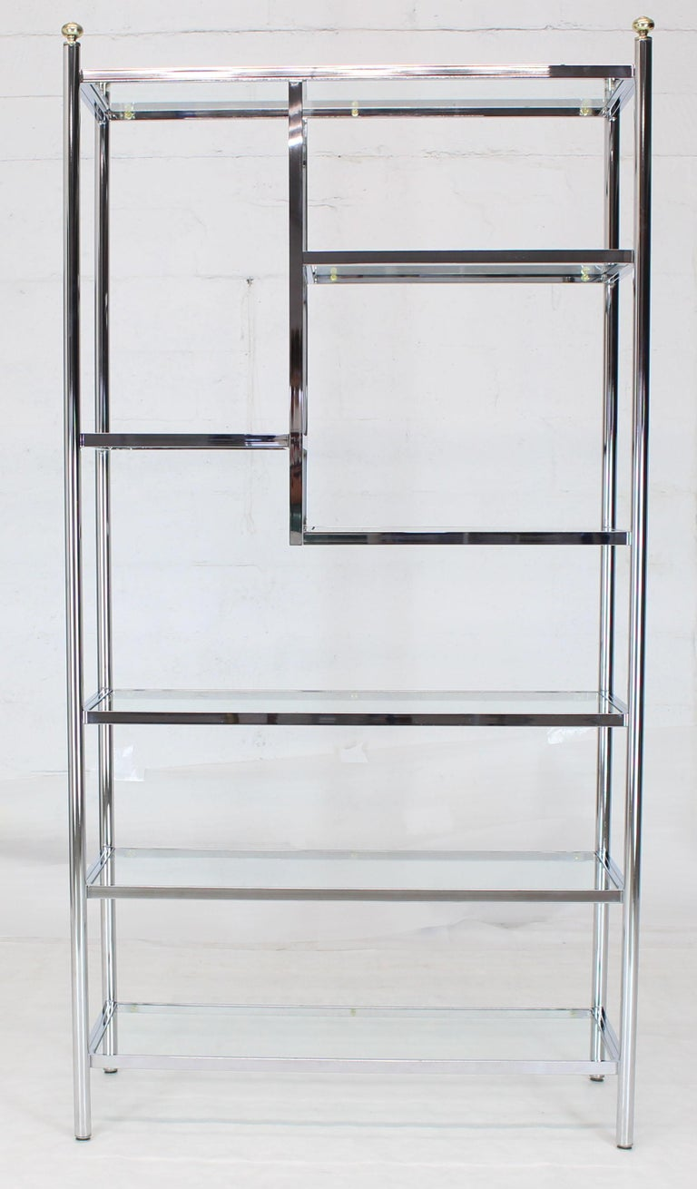 Mid-Century Modern large, staggered configuration brass chrome and glass étagère.
