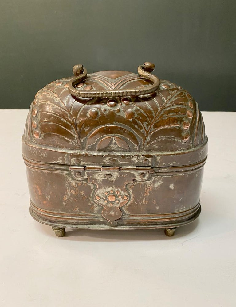 This is a very decorative Dutch Repouse foot warmer that most probably dates to the late 18th or early 19th century. The warmer is in overall good condition, but showing deep natural acquired over many years of use. This would make great decorative