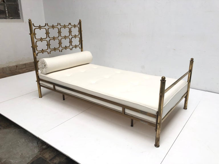 Beautiful and important brass single  bed or day bed  circa 1958-1963  by Osvaldo Borsani and famed italian sculptor Arnaldo Pomodoro.  The small series of  Borsani beds designed in collaboration with Pomodoro were produced in several different