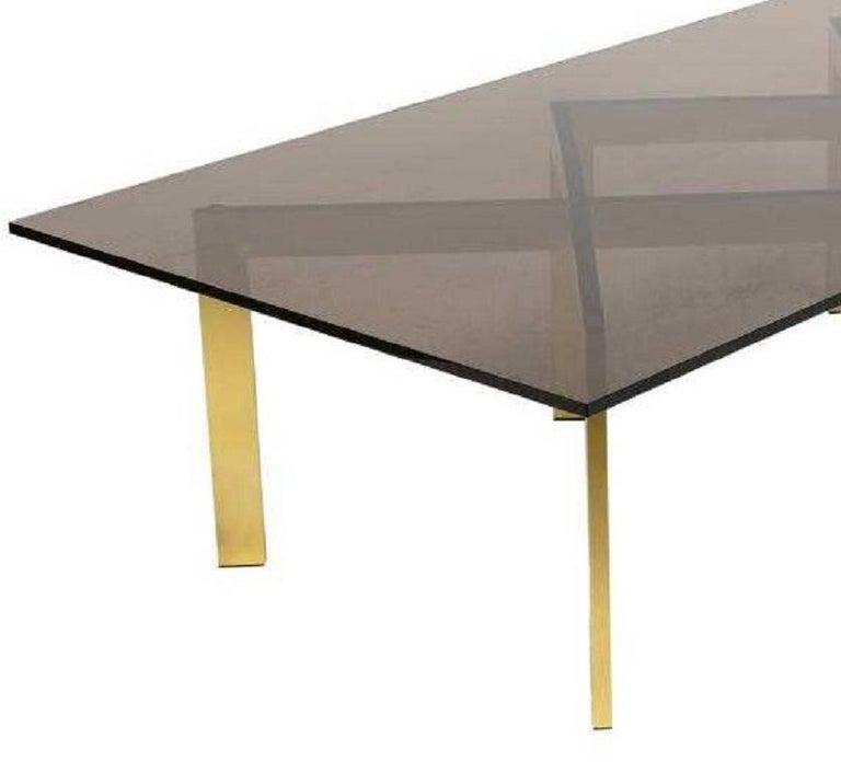 Brass double X base coffee table by Thayer Coggin with a smoked glass top.