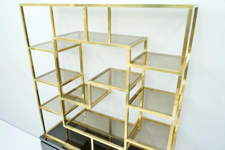 Mid-Century Modern Brass Étagère Shelf or Room Divider with Black Sideboard by Kim Moltzer, 1970s For Sale