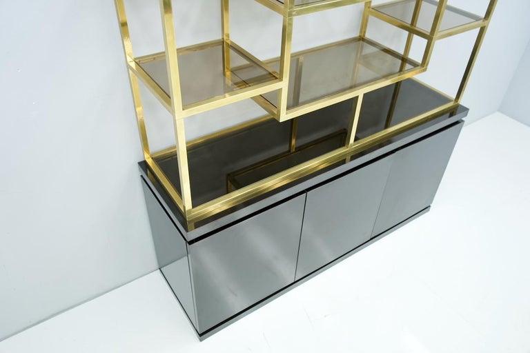 Late 20th Century Brass Étagère Shelf or Room Divider with Black Sideboard by Kim Moltzer, 1970s For Sale