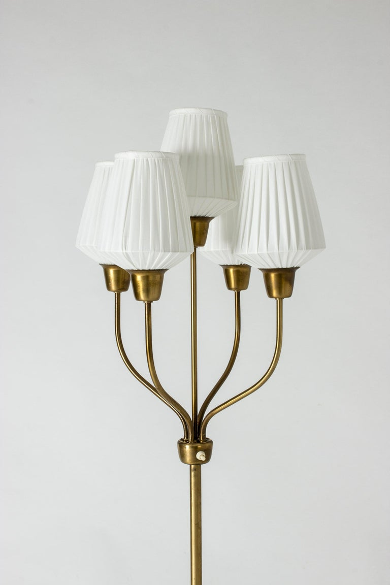 Elegant brass floor lamp by Hans Bergström with five shades on graceful arms.
