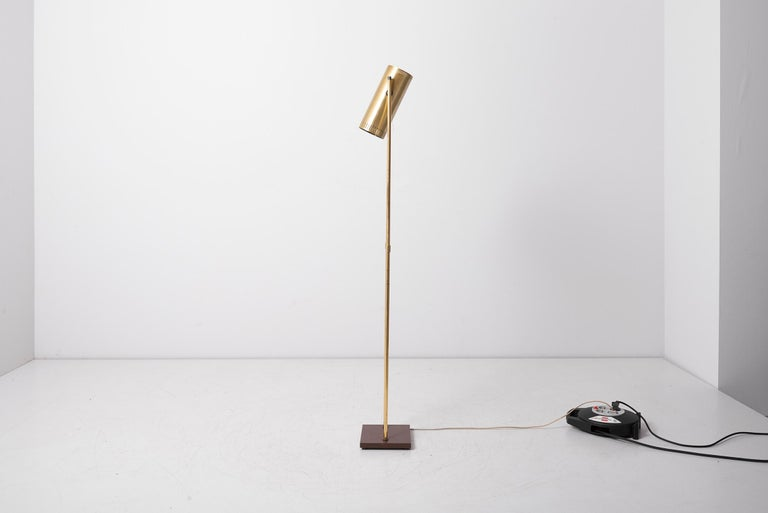 Scandinavian Modern floor lamp named 'Trombone' with adjustable lamp shade. Designed in 1960s by Jo Hammerborg and manufactured by Fog & Mørup in Denmark. This is the rarer version made of brass in good vintage condition (newly rewired).    1