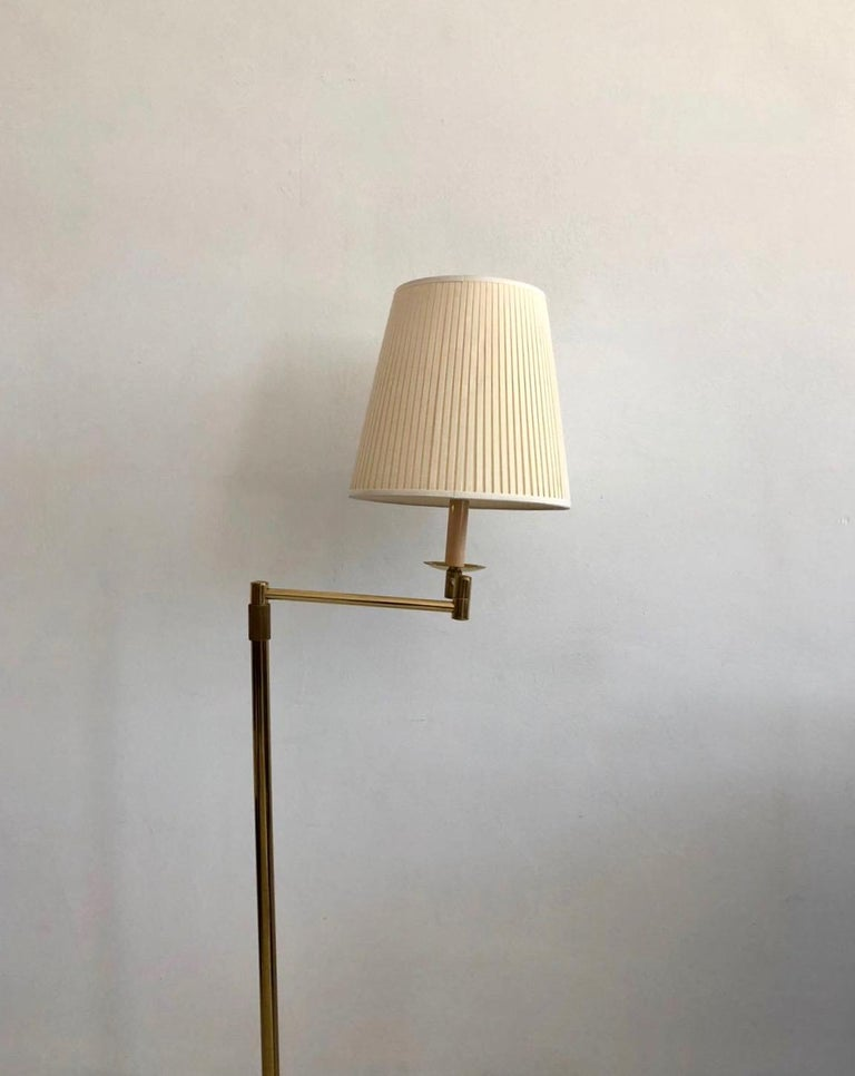 Mid-Century Modern Brass Floor Lamp with Adjustable Arm and Cream Color Shade For Sale