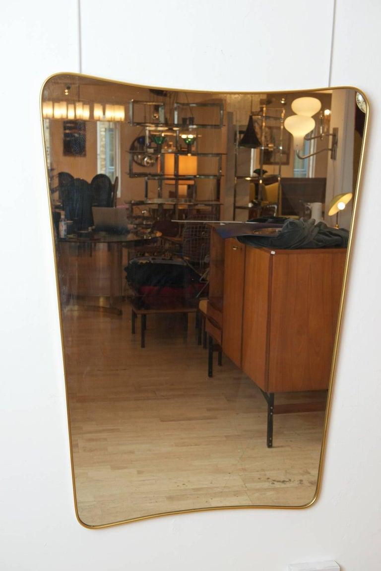 Italian brass framed mirror.