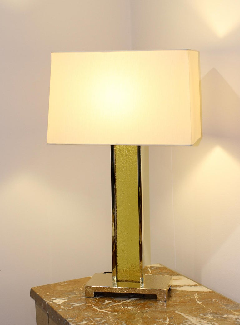 PM STUDIO Model PM2  Brass and Glass Table Lamps, Set of 3 Unique, from a special order. Beautiful set of three tall table lamps. The base is in hammered solid cast bronze, the body is in polished brass, framing an authentic 17