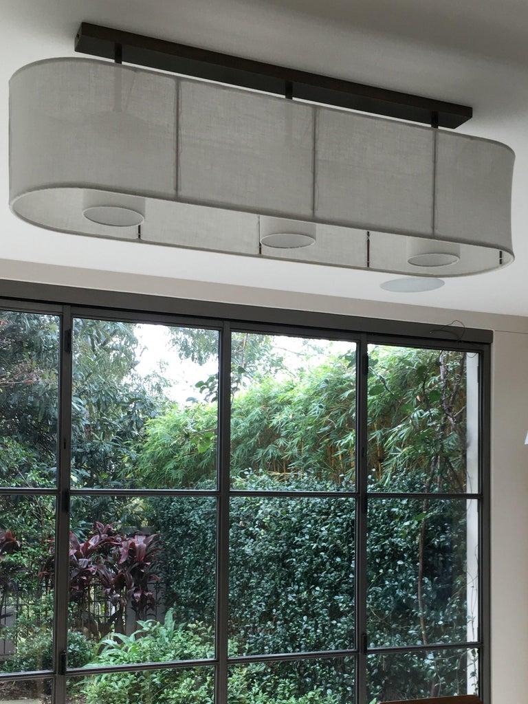 Minimalist Brass Horizontal Oval Linen Shaded Horizon Triple Ceiling Light by Wende Reid For Sale