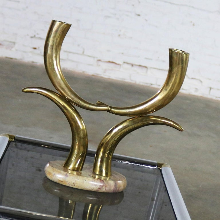 Handsome brass horn shaped or tusk shaped candle holder on oval stone base. This piece is in wonderful vintage condition. We have left the brass unpolished having its gorgeous age patina. If you prefer it to be polished, let us know, circa 1970s.