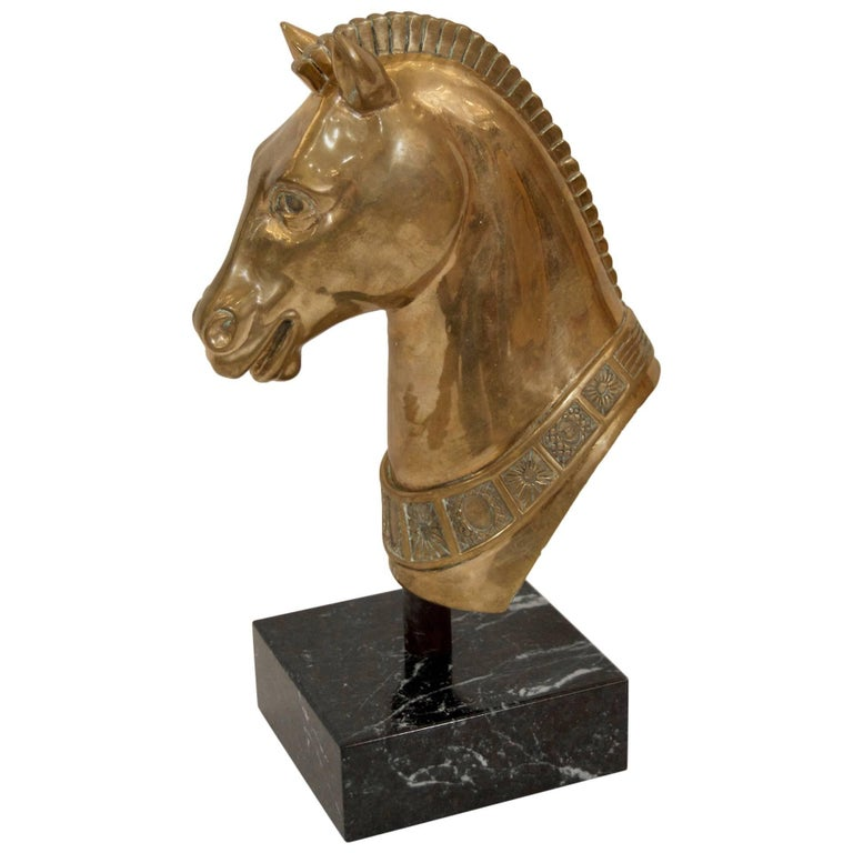Well detailed solid brass sculpture of a horse head on a marble base.