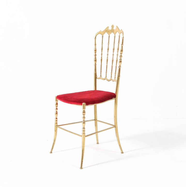 Stunning and elegant Mid-Century Modern chair. Design by Chiavari. Striking Italian design from the 1960s. Solid brass frame with original red velvet seat. In very good condition with minor wear consistent with age and use, preserving a