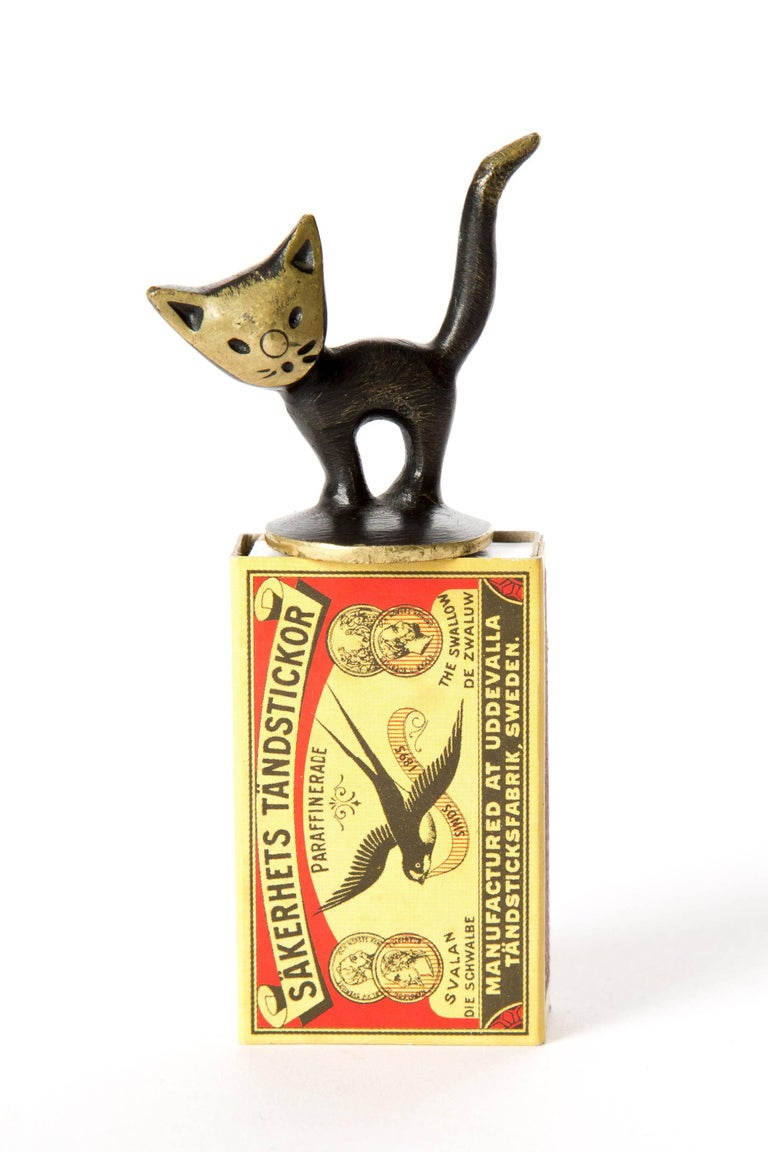 Brass kitten cat Walter Bosse. Young kitten made of blackened brass. There is a stamp underneath. Baller Austria. Probably made for extinguish fire of a cigarette.