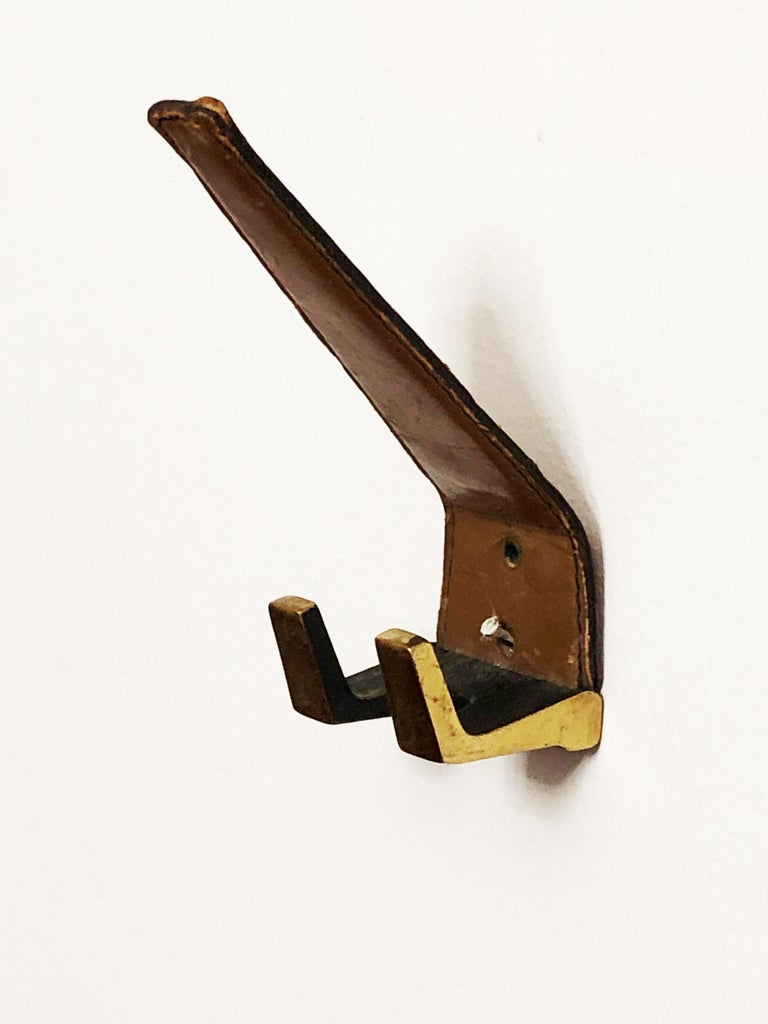 Austrian Brass Leather Wall Hooks  For Sale