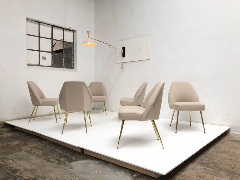 Amazing set of ten restored 'Campanula' dining chairs by italian architect Carlo Pagani (architectural partner of both Gio Ponti and Lina Bo Bardi) for Arflex, Italy, 1952.  These are early examples identified by their artisan crafted solid wood