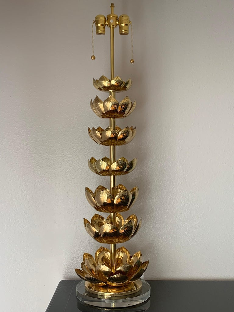 Brass lotus lamp attributed to Feldman. Recently polished and mounted on acrylic base. Requires two up to 60watt E27 base bulbs.