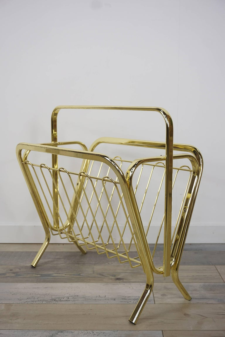 Brass magazine rack in Hollywood Regency style. Elegance and transparency for this superb gilt metal magazine rack. All in excellent condition!