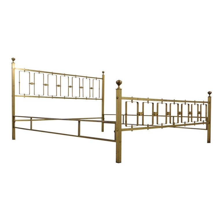 This Circa 1960s Modern Italian Style Queens-Size Bed has a solid brass frame, features two rails, head, and footboard. The boards have geometric pattern design panels & columns with brass accents on top corners. This queen-size bed is sturdy,