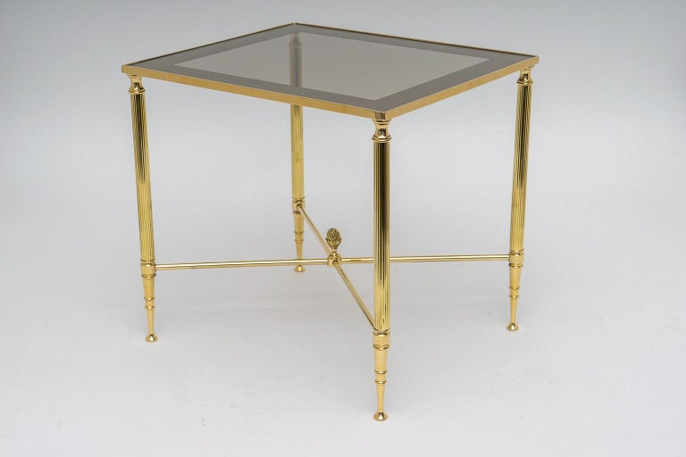 This stylish and chic three-piece set of nesting tables were acquired from a Palm Beach estate and they have been professionally polished as of June 2019. The inset tops are clear glass with a mirror border.  Note table dimensions: Largest table